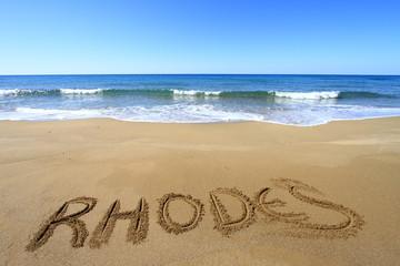 Rhodes written on sandy beach