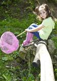 Cute toddler holding a butterfly net