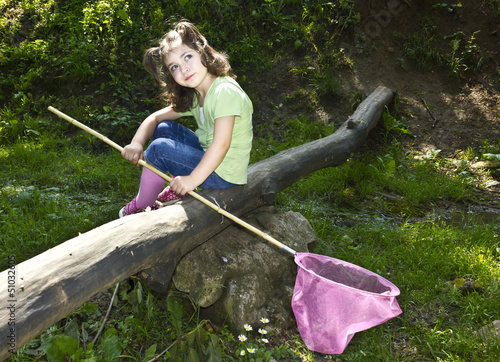 Cute toddler holding a butterfly net