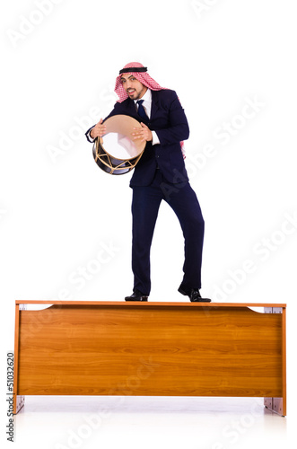 Arab businessman playing drum on desk