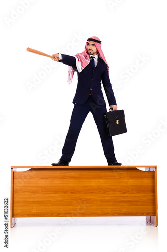 Arab businessman hitting with baseball bat