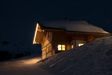 Beautiful skiing hut at night