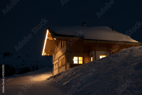 Beautiful skiing hut at night