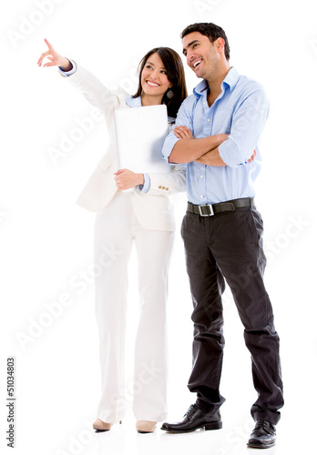 Business couple pointing away