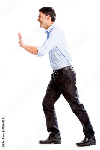 Business man pushing object