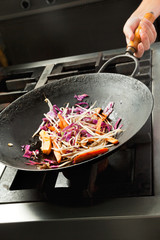 Chef Cooking Vegetables In Wok