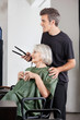 Woman With Coffee Cup And Hairdresser Holding Straightener