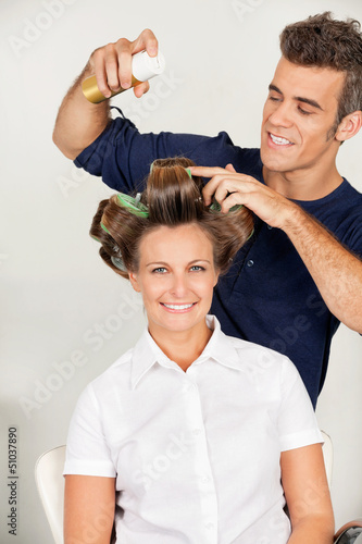 Customer With Hairstylist Setting Curls With Hairspray