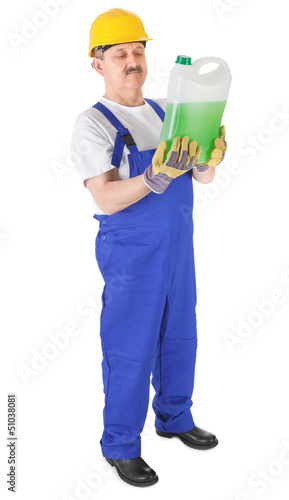 manual worker with green liquid