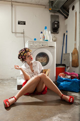A housewife reading a book and dreaming in the laundry room