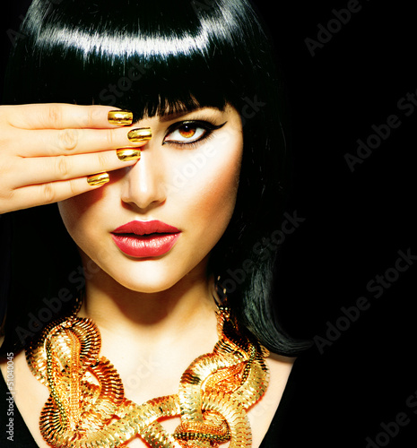 Beauty Brunette Egyptian Woman.Golden Accessories