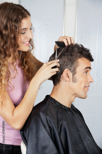Female Hairdresser Cutting Client's Hair