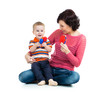 Mother and baby boy having fun with musical toys. Isolated on wh