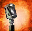 Vintage microphone on grunge background