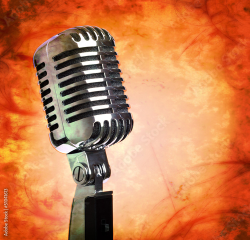 Vintage microphone on grunge background