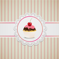 Cupcake with pink creme on lace and striped table cloth