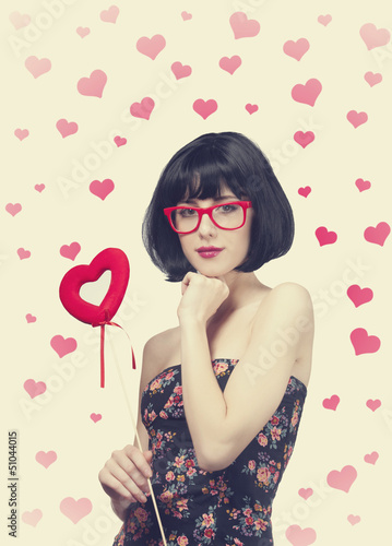 Beautiful girl with toy heart.