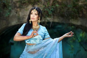 Beautiful indian woman in Sari. Arabian bellydancer