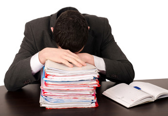 Exhausted worker sleeping on a pile of files. Isolated on white.