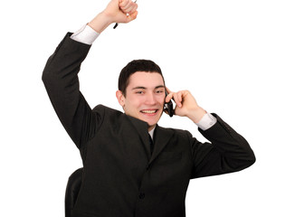 Businessman with hand up receiving good news on the phone.