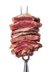 Scheiben Steak auf einer Fleischgabel