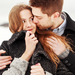 Beautiful sensual closeup portrait of young attractive couple