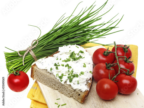 a slice of bread with cheese and chives - healthy food