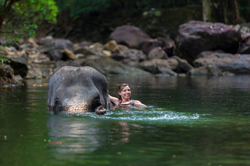 the girl with the elephant in the water