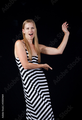 pretty blond in stripped dress,  looking at the camera