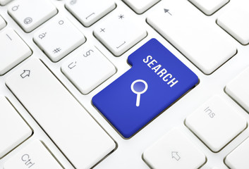 Search business concept, blue enter button or key on white keybo