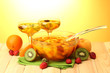 punch in bowl and glasses with fruits,