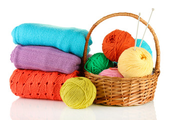 Sweaters and balls of wool isolated on white