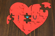 "Puzzles in form of heart with words ""I love you"""