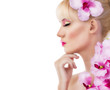 Beautiful woman with flowers and pink makeup