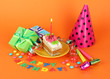Colorful birthday cake with candle and gifts