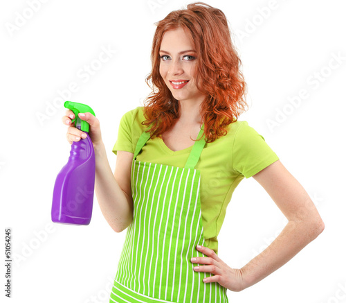 Young woman holding sprayer, isolated on white