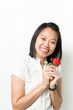 Asian lady hold red rose