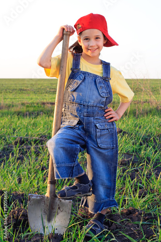 Smiling girl with shovel
