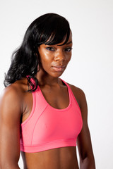Black girl in workout cloths, with serious expression