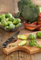 Brussels sprouts and broccoli on wooden table
