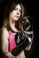 Boxing woman, pretty young boxing  and defending by hands  black