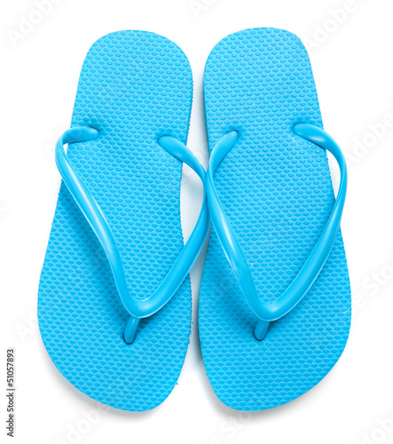Light blue flipflops on a white background