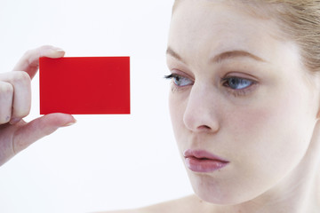 Close up of business card being shown by businesswoman