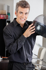 Male Hairstylist With Steamer At Salon