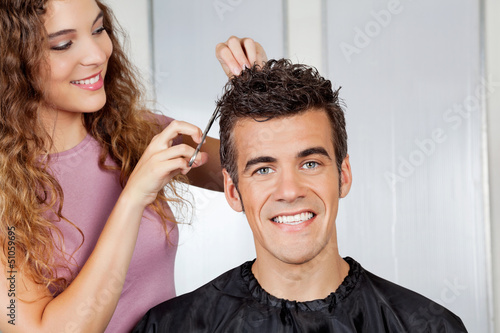 Client Getting Haircut From Hairdresser