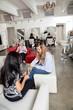 Customer Having Manicure At Parlor