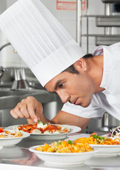 Chef Garnishing Pasta Dishes