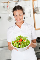 Female Chef Showing Vegetable Salad