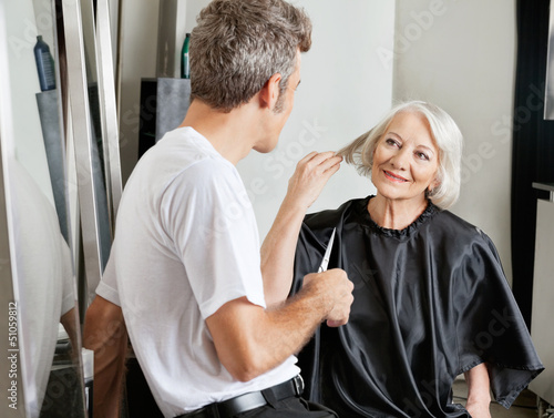 Client Instructing Hairdresser In Salon