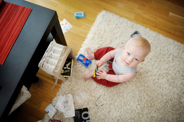 Adorable baby girl making a mess